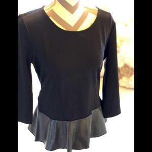 Peplum 3/4 sleeve sweatshirt with faux leather.